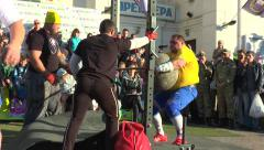 Athlete four times throws a stone ball 160 kg Stock Footage