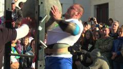 Athlete twice throws stone ball 160 kg Stock Footage