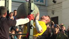 The athlete from the Ukraine three times throws a stone ball Stock Footage