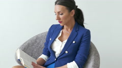 4K Modern Young Pretty Business Woman reading book Seating - stock footage