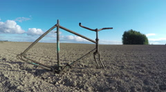 Old broken rusty bicycle frame on farm field. Timelapse 4K Stock Footage