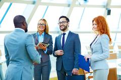 Happy multi-ethnic business people having consultation Stock Photos