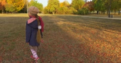 Little Girl With Blonde Braid Girl in Beret Red Scarf and Jacket is Walking by - stock footage