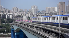 Light rail train driving on bridge in Chongqing Stock Footage