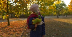 Little Girl With Fair Braid Girl in Beret is Standing and Looking at Her Stock Footage