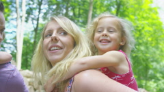 4K Happy family spending time outdoors in the woods - stock footage