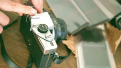 person who explain and teach how old vintage retro film camera works - stock footage