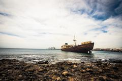 broken ship near Lanzarote coast - stock photo