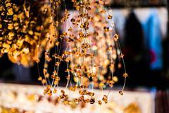 amber bracelets on market - stock photo