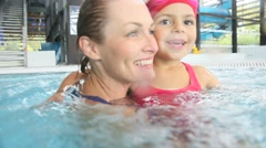 Mother and daughter training at the swimming-pool Stock Footage