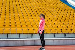 Sports woman standing at stadium Stock Photos