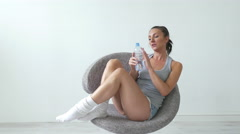 4k Sports Young Sexy Woman sitting and Drinking  Water After Exercising Training Stock Footage