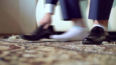 The Man Wears Black Shoes - stock footage