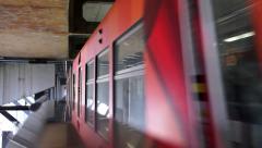 Light rail train driving under bridge Stock Footage