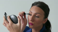 4K Beautiful Young business Woman Applying Natural  Mascara Make-Up, Isolated Stock Footage