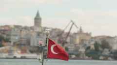 Turkish Flag flown on small fishing boats in Golden Horn in Istanbul Stock Footage