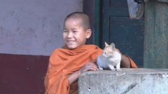 Buddhist boy with a cat, Myanmar. Stock Footage