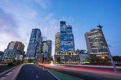 Modern buildings and traffic trails in downtown Melbourne Stock Photos