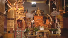 Buddha statue on an altar in the monastery, Myanmar. Stock Footage