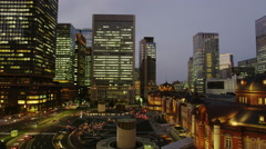 Evening View of Office Buildings surrounding Tokyo Station - stock footage