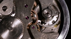 Old stopwatch clock gears mechanism running, close up, shot with macro lens Stock Footage