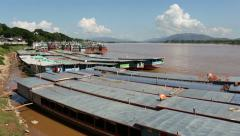 Laos and Chinese cargo boats in Mekong river Stock Footage