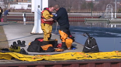 Police and fire marine ice water rescue training Stock Footage