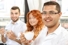 Coffee break of busines colleagues Stock Photos