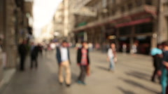 Out of focus background and unrecognizable people walking in Istiklal Street - stock footage