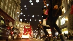 Christmas shoppers and traffic at night in Oxford Circus - stock footage