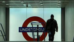 Travellers exit the Kings Cross London Underground station Stock Footage