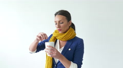 4k Beautiful young business  woman drinking hot tea winter time - stock footage