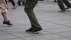 Street dancers legs perform dance step on pavement. 4K Stock Footage