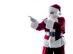 santa claus showing pointing silhouette isolated - stock photo