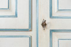 Vintage armoire detail with key and decoration Stock Photos