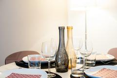 Stock Photo of Round set table in house with cutlery light colors