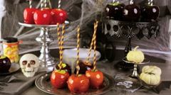 Table with colored candy apples for Halloween party. Stock Footage