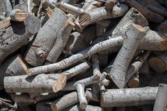 Pile of firewood as background. - stock photo