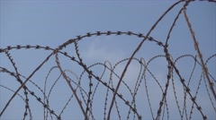 Barb wire fence Stock Footage
