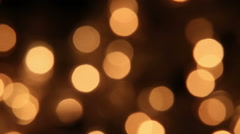 slowly blinking christmas lights bokeh seamless loop background - stock footage