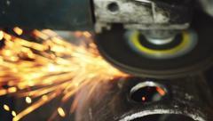 Stock Video Footage of Metal worker grinding steel pipe in workshop