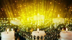 Burning candles and glitter particles in light beams loop Stock Footage