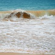 waves sea and yellow sand - stock photo