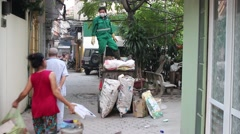 Waste workers and car senses Stock Footage