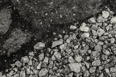 Rough gravel meets smooth Tarmac in black and white - using diagonal composit Stock Photos