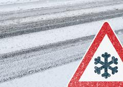 Snowy Road with Warning Sign Stock Photos