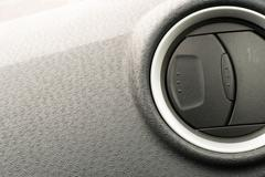 Stock Photo of Grey car interior dashboard with an air conditioning vent with nobody in view