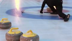 Curlers throw stones for curling on ice. - stock footage