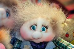 Needlework, original toys in the form of amusing dolls - stock photo