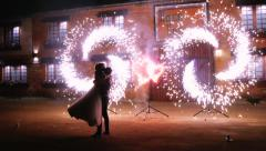 Married couple dancing during wedding fireworks Stock Footage